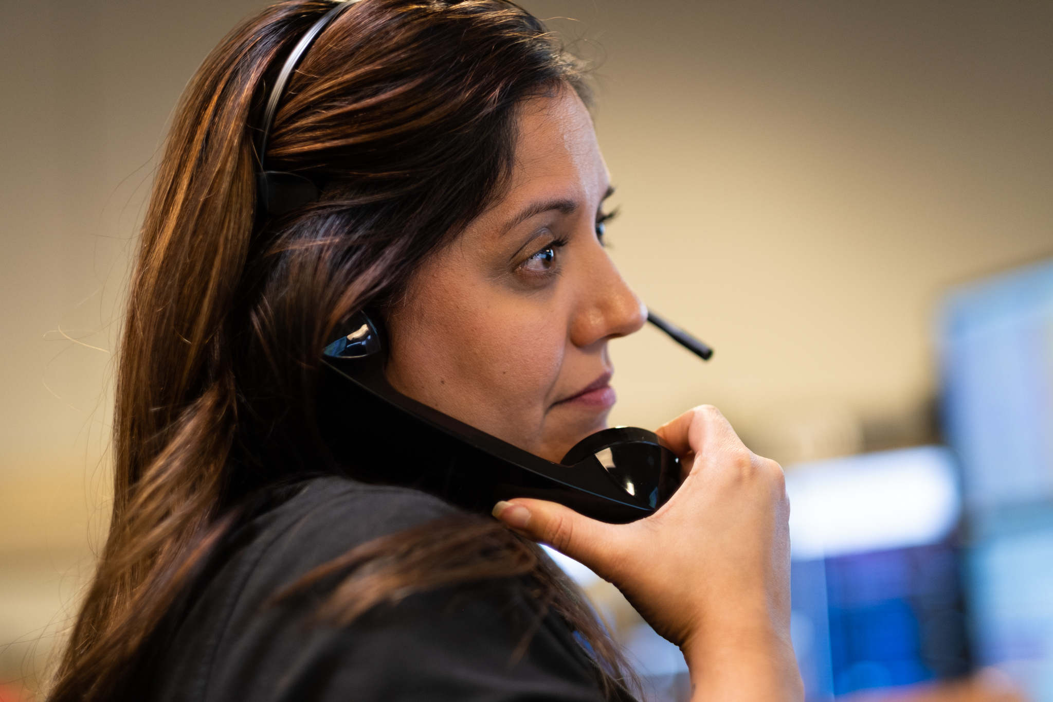 Woman smiling while talking on a phone